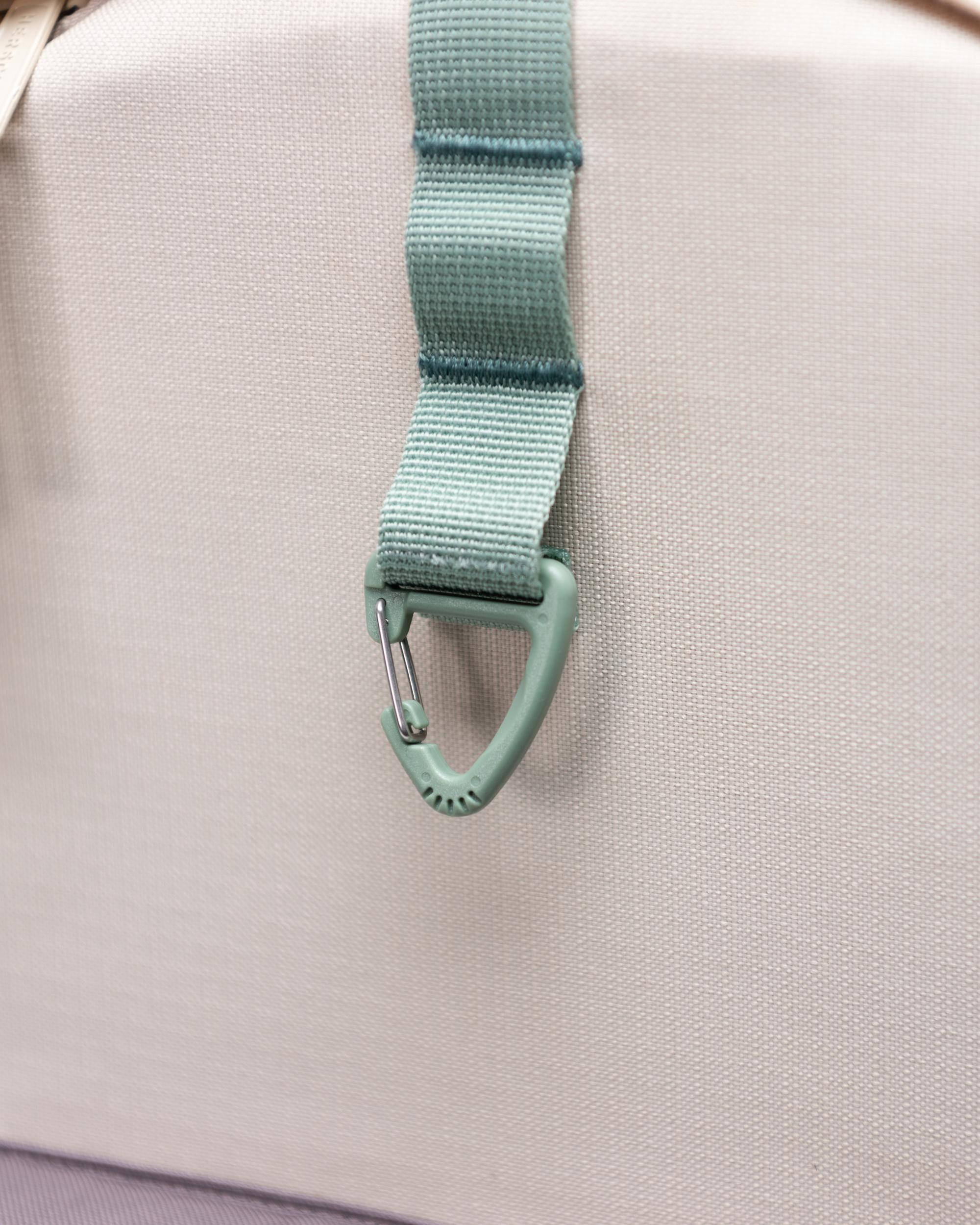 Top strap with triangle key clip