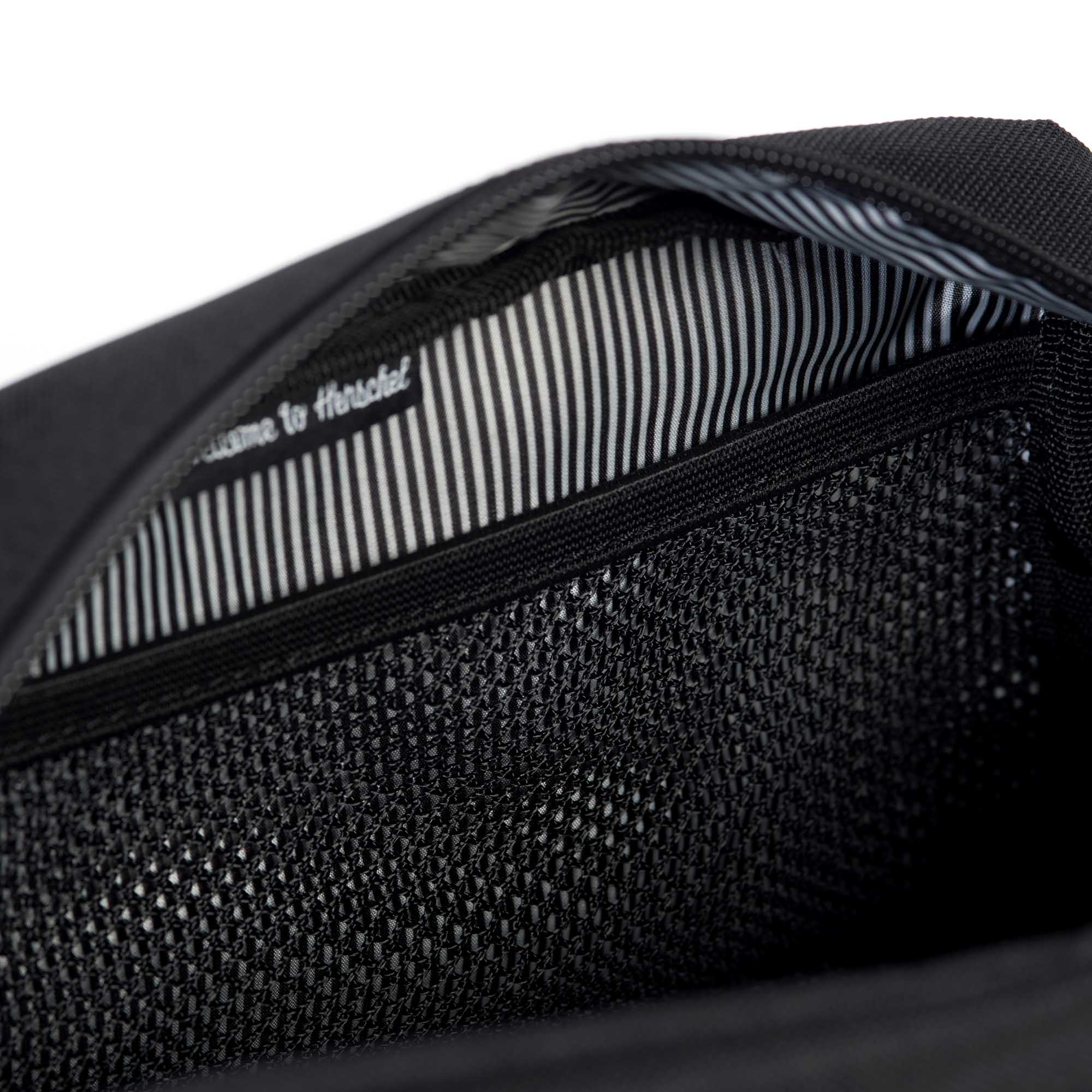 4274557ab90 Signature striped fabric liner  Internal mesh storage sleeve ...